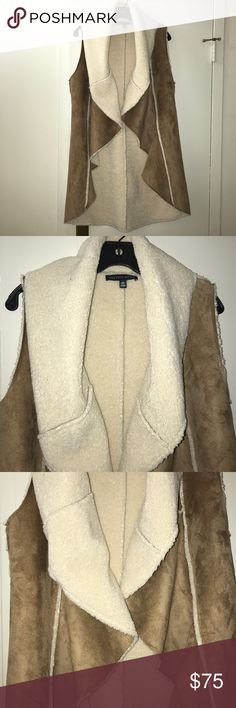 Saks Fifth Avenue faux shearling tan & cream vest NWOT. Ultra soft Saks Fifth Avenue faux shearling tan & cream vest. Extremely warm and cozy. Worn only once! Saks Fifth Avenue Jackets & Coats Vests