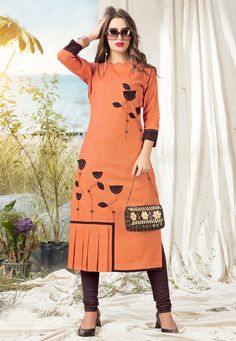 This orange cotton party wear kurti is including the charming glamorous showing the feel of cute and graceful. The patchwork work on attire personifies the full look. (Slight variation in color, fab. Printed Kurti Designs, Churidar Designs, Kurta Designs Women, Party Wear Kurtis, Kurti Designs Party Wear, Stylish Dress Designs, Stylish Dresses, Khadi Kurti, Plazo Kurti