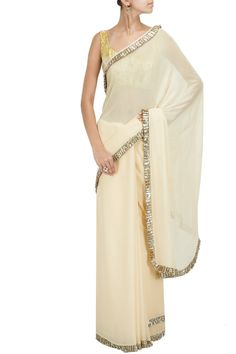 Nude sequins frill detailing sari with olive printed blouse BY MANISH MALHOTRA