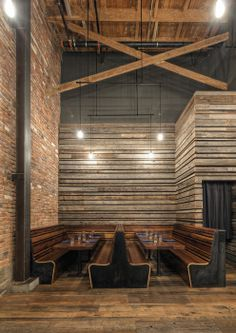 The long booths and the wood walls make this space look huge