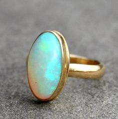 Opal Ring  Opal Gold Ring  Opal 18 KT Solid Gold Ring by lsueszabo  Sometimes the simplest, most classic settings are perfect to showcase the exceptional beauty and quality of a stone.