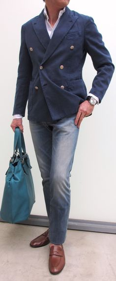 Navy double-breasted jacket, white shirt, jeans