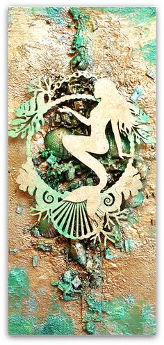 Scraps of Darkness scrapbook kits; Mixed media mermaid canvas, created with our July An Ocean Tale Kit by Wilma Voermans. Join our…