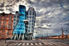 We can dance if we want to! The Dancing House in Prague puts a new twist on modern architecture. Originally named Fred and Ginger, this unique building stands out among the Baroque, Art Nouveau and Gothic architecture Prague is famous for. Unusual Buildings, Amazing Buildings, Amazing Architecture, Art And Architecture, Prague Architecture, School Architecture, Modern Buildings, Frank Gehry, Where Is Prague