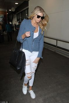 Looking all white! Charlotte looked angelic in her matching outfit as she headed to her flight
