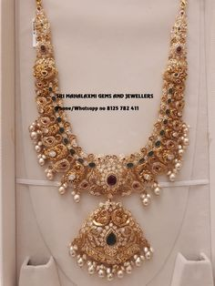 Best Long haram designs at Wastage charges from market. Stunning gold necklace in dancing peacock motifs. necklace studded with multi precious stones. Necklace with south sea pearl hangings. Visit for latest designs. Contact no 8125 782 411 19 June 2019 Jewelry Design Earrings, Gold Jewellery Design, Gold Jewelry, Gold Necklace, Necklace Designs, Bee Jewelry, India Jewelry, Bridal Jewelry, Pendant Necklace