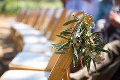 olive branches tied to chairs on the aisle #wedding #rustic