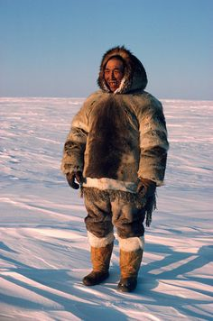 Inuit Hunter dressed in traditional fur clothing - Canadian Eastern Arctic