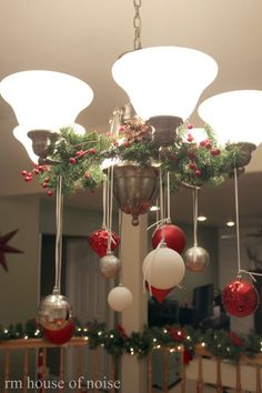 Love the greenery and the ornaments hanging down.....gorgeous.... Christmas Chandelier Decor, Christmas Decorations Diy Cheap, Christmas Decorating Ideas, Ideas For Christmas Dinner, Kitchen Chandelier, Christmas Decor For Bathroom, How To Decorate For Christmas, Christmas Decorations For The Home Living Rooms, Christmas Decorations Dinner Table