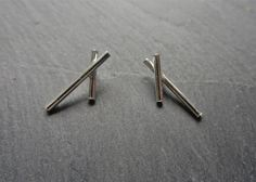 Simple witchcraft. A little hex. Criss cross protective earrings. Little sterling silver studs.