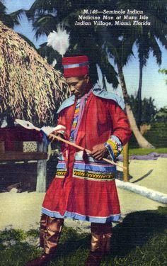 Visiting a Seminole Indian medicine man at Musa Isle Indian Village. | Florida Memory