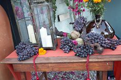 table setting, rustic design, grapes, vibrant colors, candles, rope, event planning, kristin banta designs