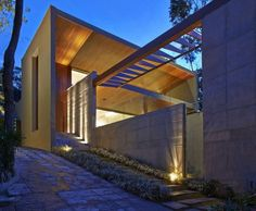 beautiful modern home exterior design with stone walkway and warm floor lights