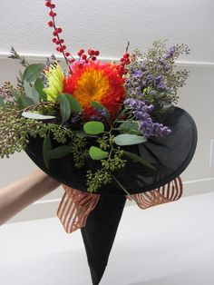 I love this pretty bouquet idea for a Halloween-themed wedding.  Seen on 'Petal to the Metal Flowers' site; http://www.petaltothemetalflowers.com/themes.html#