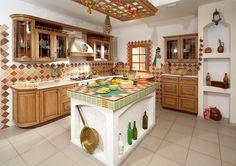 Если решили сделать кухню без печи - можно попробовать стилизовать под нее остров или другие элементы кухни