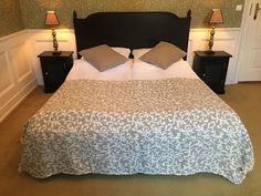 Classic,beige bedspread with pillows in the same colour.