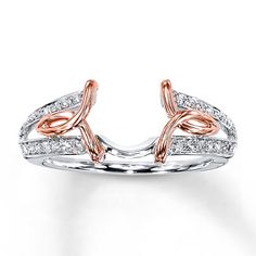 Beautiful setting... picture it with a 1 carat round cut diamond in the middle... I love rose gold and white gold!