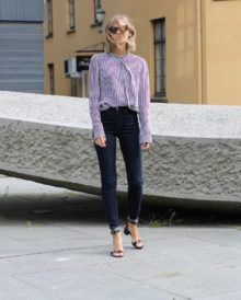 Tine Andrea adds a shirt to make this look timeless and classic. Her high waisted jeans are complimented with a soft striped shirt with feminine tie. Rolled at the ankle, these jeans meet a low heeled, buckled sandal, adding an air of elegant cool to this outfit. Shoes: ATP Atelier, Jeans: Weekday, Shirt from: Zara