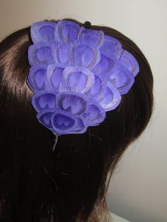 Hey, I found this really awesome Etsy listing at https://www.etsy.com/listing/111698710/purple-peacock-eye-feather-fascinator
