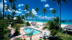Secluded pool in garden area in the Caribbean Village at Sandals Grande Antigua. This resort is perfect for an all-inclusive honeymoon resort, your all-inclusive honeymoon package, destination wedding package, or other romantic vacation for two.