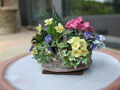 miniature spring flowers basket