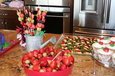 fruit skewers and licorice for lady bug birthday party