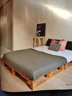 """DIY Pallet Bed...pallets """"lifted"""" by blocks for more height...nicer than right on the floor...easier on older backs and knees and makes room for underbed storage"""