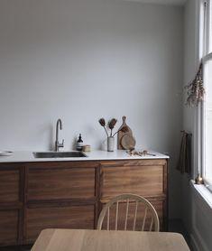 Minimal kitchen with warm wood tones.