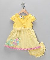 Your sweetie will be your dainty little darling this spring when she wears this adorable dress. The quaint flower appliqué and matching bloomers will make her picture-perfect for Grandma's house. Pair with lily white mary janes for a look that's as sweet as her giggles. The dress also features back button closures.Includes dress and bloomers55% cotton / 4...