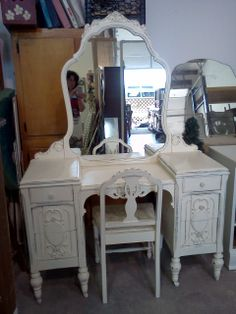 beuatifully carved vanity in off white and distressed. Please see our vintage shabby chic unfinished furniture board for available pieces. These are pictures of past projects and are not available
