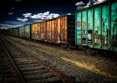 Boxcars  Trackside - Original fine art industrial railroad train photography by Bob Orsillo  Copyright (c)Bob Orsillo / http://orsillo.com - All Rights Reserved.  Buy art online.  Buy photography online   Old paint peeling, rusty, graffiti covered boxcars still in service - hauling freight down the tracks.