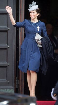 Mary wore a smart blue coatdress, with grey accessories.