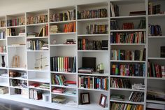 I've always wanted a wall like this, full of movies, books, and pictures!