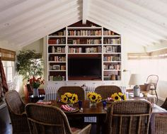 I like the idea of this angled bookcase in the informal dining room.