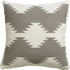loom the room. Handloomed of slubby cotton/poly, this graphic pillow weaves a modern interpretation of a traditional Turkish kilim. Soft yet graphic with bursts of white on grey, pillow reverses to a solid field of white. Do the math: CB2 low prices include a pillow insert in your choice of plush feather-down or lofty down-alternative (a rare thing indeed).