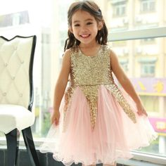 Gown perfection for your princess! Stunning peach/pink sequin top attached to a gorgeous organza skirt. Wash & Care Instructions: Dry Clean or Hand Wash and hang or lay flat to dry. Do not bleach.