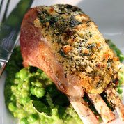 Herb crusted rack of lamb with pea, mint and shallot sauce