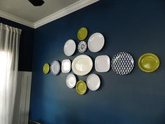 Plate wall - find center, tape, and nail through the tape! Great idea for unique plates to display