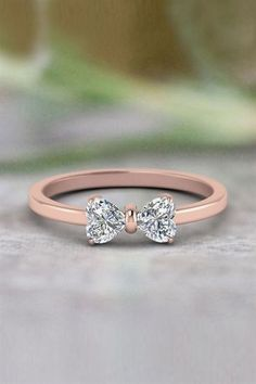 Shop 2 heart shaped bow diamond ring in 14K rose gold at Fascinating Diamonds. Make your soulmate more special by gifting this beautiful Anniversary Gifts.  #JewelryRings #beautifulring #engagementrings #diamondrings #goldrings