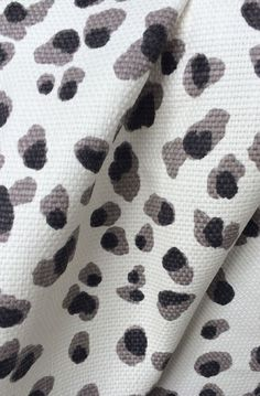 leopard print fabric in black, grey and white. Now in stock at www.tonicliving.com (or click on image to buy or swatch). #tonicliving #leopardfabric #homedecor