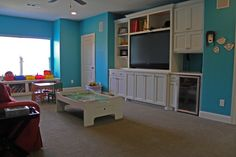 Game Room with tv, refrigerator, and plenty of play space & storage...