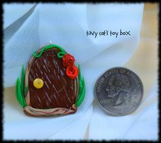 Hand-Crafted Polymer Clay Fairy Door Charm    http://www.etsy.com/shop/TinyCatsToyBox