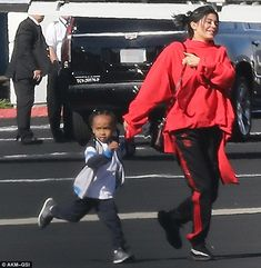 Having a blast:Kylie sweetly held hands with Tyga's son King Cairo, four, as they made their way to the plane