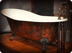 I have always wanted a clawfoot tub- this one would be perfect... Clawfoot tub. Aged bronze and rust finish