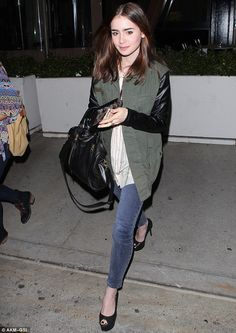 Low-key style: Lily Collins rocked the military chic look as she headed out to dinner at Red O restaurant in West Hollywood on Tuesday night