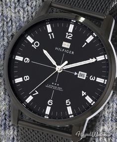 The extremely sleek #TommyHilfiger 1710328 #watch would appeal to any guy -- a striking contrast of white markers, numerals and hands against a black dial and gunmetal case & nylon strap makes it fit any outfit.