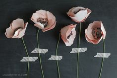 Or, go one step further, and hang homemade paper flowers.   28 Decorating Tricks To Brighten Up Your Rented Home