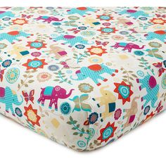 """The Zahara Fitted Sheet is made from 100% cotton with a lively elephant and floral pattern. Designed to fit a standard 28""""x52"""" crib mattress, sold separately."""