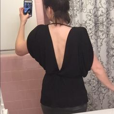 VS Low Back Surplice Blouse A sexy black blouse with a double-V style that dips in front and back. The back goes much lower than the front so you're covered! Dolman sleeves are split across the top of the shoulder to show some skin. Super comfy, stretchy silky material. Happy to answer any q's! Only worn once to a birthday outing. Victoria's Secret Tops Blouses