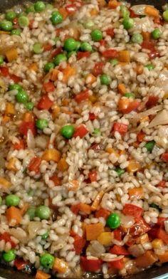 Arroz bomba al estilo del risotto, con verduras, aromatizado con zumac